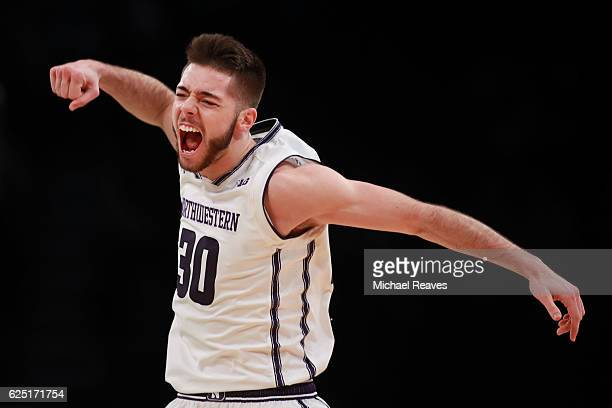 Bryant McIntosh of the Northwestern Wildcats celebrates after hitting a three pointer against the Notre Dame Fighting Irish in the second half during...