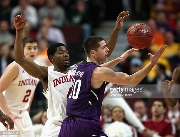 Bryant McIntosh of the Northwestern Wildcats grabs for a loose ball under pressure from Robert Johnson of the Indiana Hoosiers during the second...