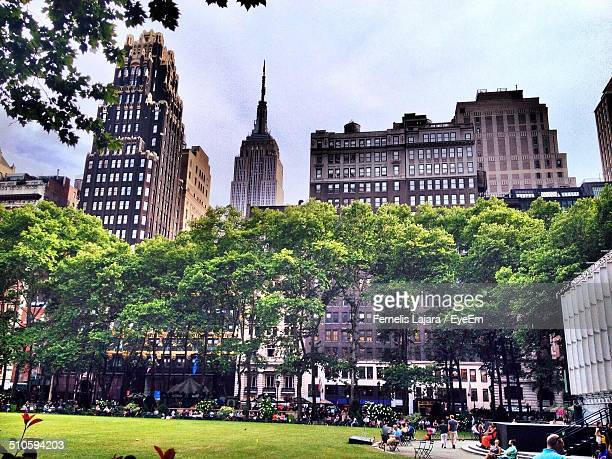 bryant park against buildings - bryant park stock pictures, royalty-free photos & images