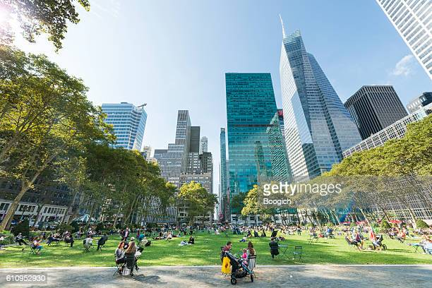 nyc bryant park on sunny autumn day midtown manhattan - bryant park stock pictures, royalty-free photos & images