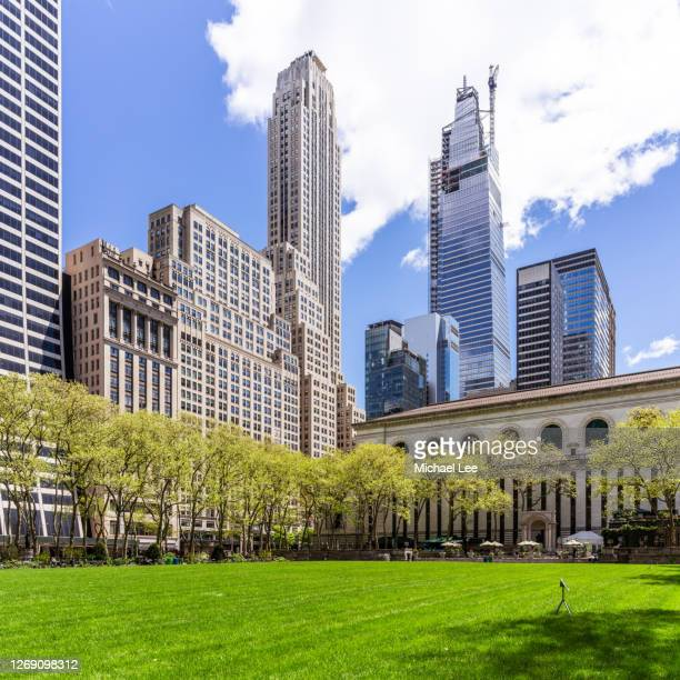 bryant park skyline view - new york - new york public library stock pictures, royalty-free photos & images