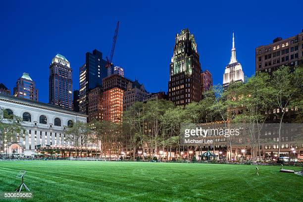 bryant park twilight view - new york - bryant park stock pictures, royalty-free photos & images