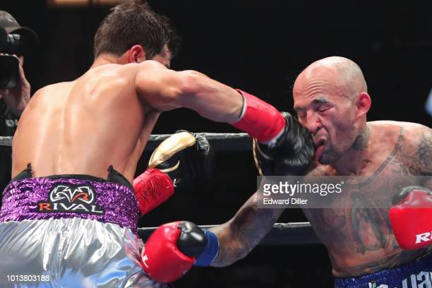 Bryant Perella ands a right hand against Luis Collazo Collazo would win by majority decision at the Nassau Veterans Memorial Coliseum on August 4...