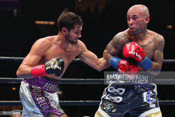 Bryant Perella lands a left hand against Luis Collazo Collazo would win by majority decision at the Nassau Veterans Memorial Coliseum on August 4...