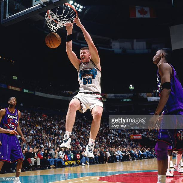 Bryant Reeves of the Vancouver Grizzlies dunks against the Toronto Raptors during the NBA game on January 19 1997 in Vancouver British Colmbia Canada...