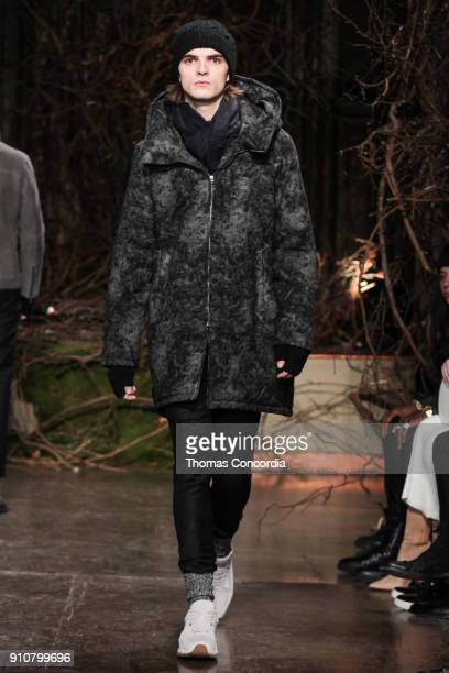 Bryant walks the runway wearing John Varvatos Fall/Winter 2018 with makeup by Chika Chan for MakeUp Pro and Hair by Yannik D'Is for Cultler/Redken at...
