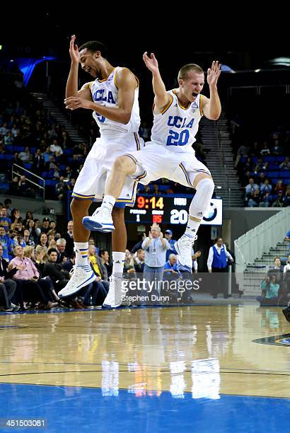 Bryce Alford and Kyle Anderson of the UCLA Bruins celebrate after an Alford three point basket in the first half against the Morehead State Eagles at...