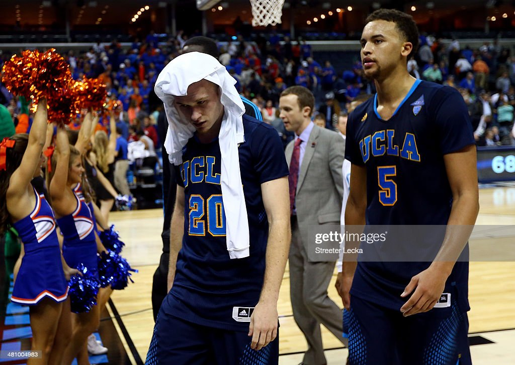 Bryce Alford #20 and Kyle Anderson #5 of the UCLA Bruins walk off the court after losing to the Florida Gators 79-68 in a regional semifinal of the 2014 NCAA Men's Basketball Tournament at the FedExForum on March 27, 2014 in Memphis, Tennessee.