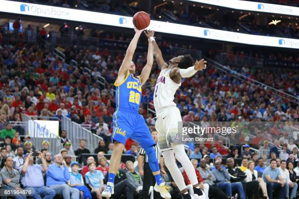 Bryce Alford of the UCLA Bruins handles the ball against Kobi Simmons of the Arizona Wildcats during a semifinal game of the Pac-12 Basketball...