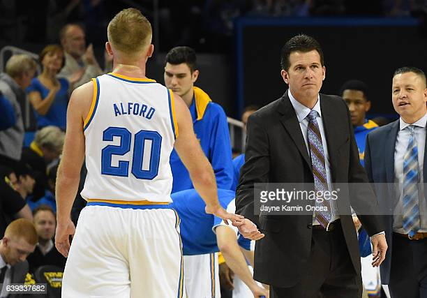 Bryce Alford of the UCLA Bruins is greeted by head coach Steve Alford during a time out in game against the Arizona State Sun Devils at Pauley...