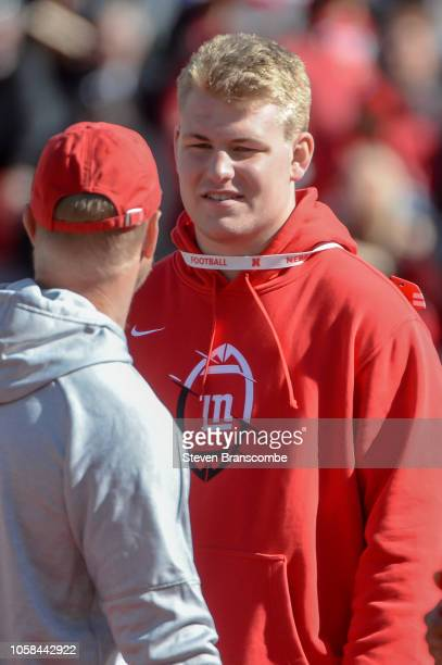 Bryce Benhart talks with head coach Scott Frost of the Nebraska Cornhuskers before the game against the Minnesota Golden Gophers at Memorial Stadium...
