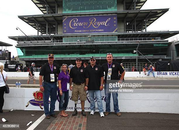 Bryce Boyer Tara Hulett John Wayne Walding James Bailey and Tyler Whisenhunt attend the John Wayne Walding Brickyard 400 John Wayne Walding received...