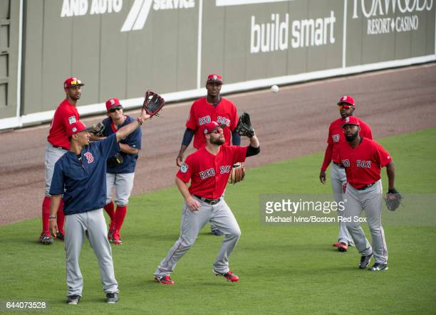Bryce Brentz of the Boston Red Sox catches a fly ball while surrounded by other outfielders Mookie Betts Chris Young Andrew Benintendi Junior Lake...