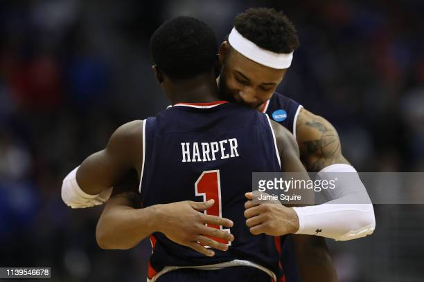 Bryce Brown and Jared Harper of the Auburn Tigers react in the final moments of their 7771 win over the Kentucky Wildcats in the 2019 NCAA Basketball...