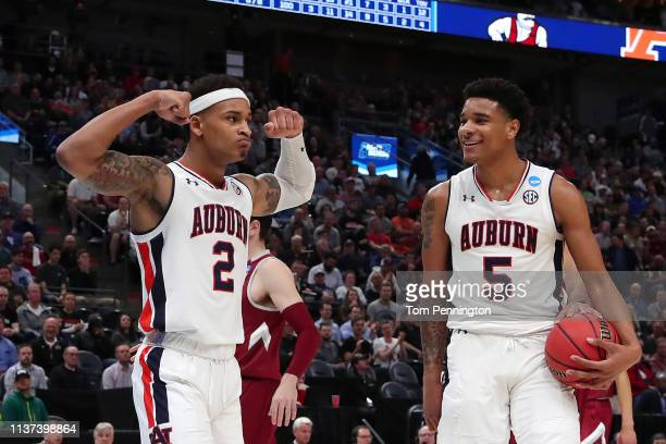Bryce Brown celebrates with Chuma Okeke of the Auburn Tigers during the second half against the New Mexico State Aggies in the first round of the...