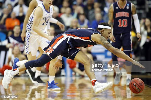 Bryce Brown of the Auburn Tigers attempts to handle a loose ball against the Kentucky Wildcats during the 2019 NCAA Basketball Tournament Midwest...
