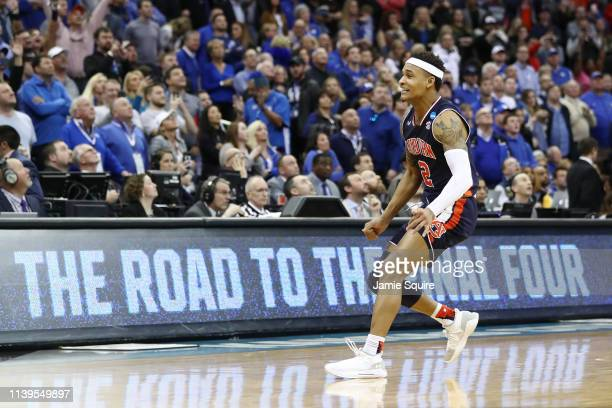 Bryce Brown of the Auburn Tigers celebrates defeating the Kentucky Wildcats 7771 in overtime during the 2019 NCAA Basketball Tournament Midwest...