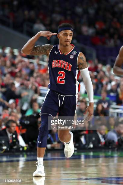 Bryce Brown of the Auburn Tigers celebrates in the first half against the Virginia Cavaliers during the 2019 NCAA Final Four semifinal at US Bank...