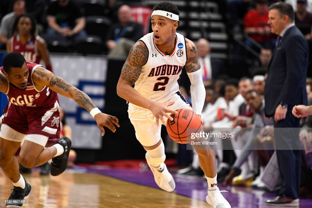 Bryce Brown Of The Auburn Tigers Dribbles The Ball Around Aj