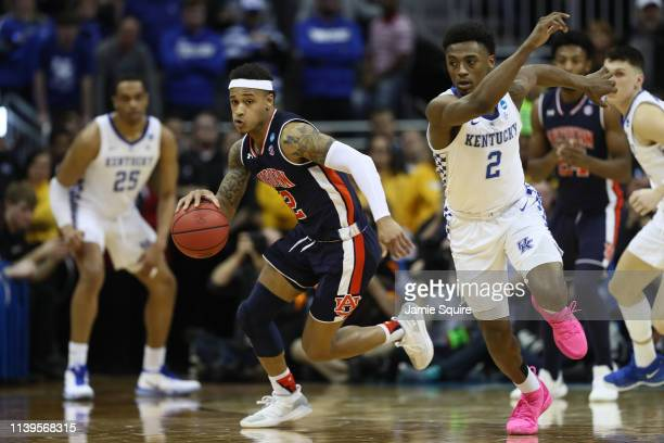 Bryce Brown of the Auburn Tigers drives with the ball against the Kentucky Wildcats during the 2019 NCAA Basketball Tournament Midwest Regional at...