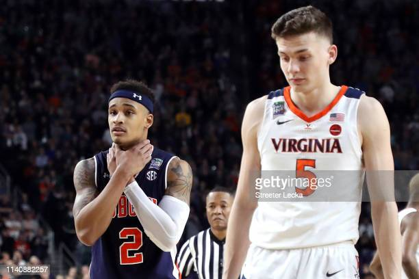 Bryce Brown of the Auburn Tigers gestures as Kyle Guy of the Virginia Cavaliers looks on in the second half during the 2019 NCAA Final Four semifinal...