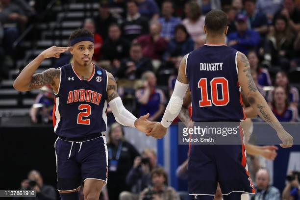 Bryce Brown of the Auburn Tigers reacts to a play with Samir Doughty during their game against the Kansas Jayhawks in the Second Round of the NCAA...