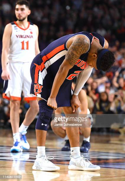 Bryce Brown of the Auburn Tigers reacts to a three pointer by Kyle Guy of the Virginia Cavaliers during the second half of the semifinal game in the...