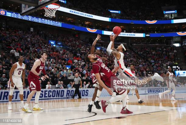 Bryce Brown of the Auburn Tigers shoots the ball against Johnny McCants of the New Mexico State Aggies during the second half in the first round of...