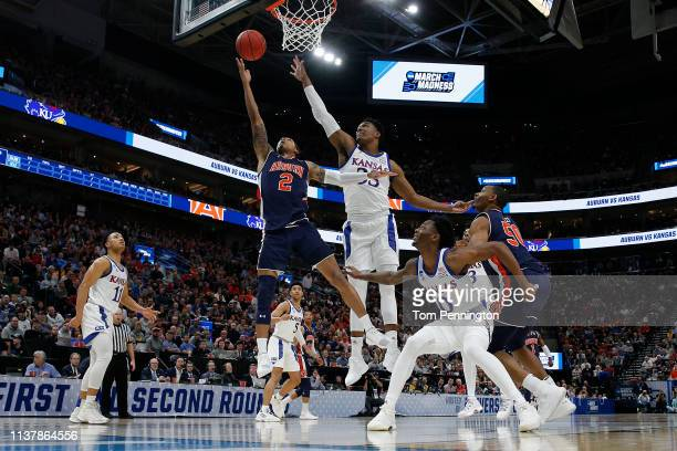 Bryce Brown of the Auburn Tigers throws up a shot against David McCormack of the Kansas Jayhawks during their game in the Second Round of the NCAA...