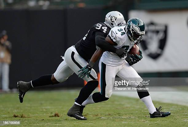 Bryce Brown of the Philadelphia Eagles gets wrapped up by Kevin Burnett of the Oakland Raiders during the third quarter at Oco Coliseum on November 3...