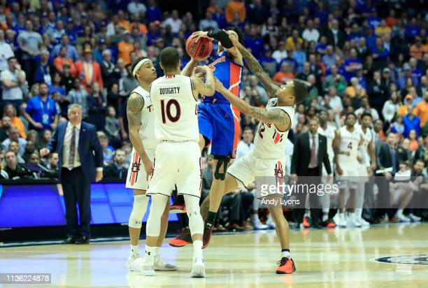 Bryce Brown Samir Doughty and J'Von McCormick of the Auburn Tigers defend the shot of Andrew Nembhard of the Florida Gators during the semifinals of...