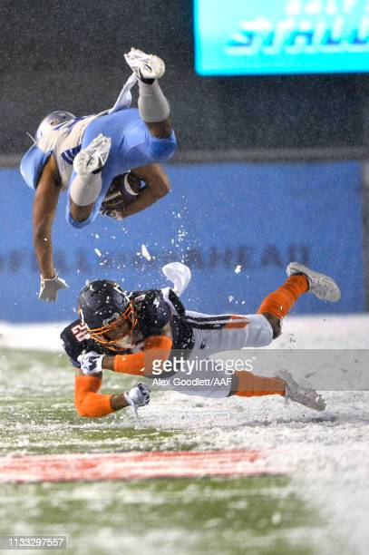 Bryce Canady of Orlando Apollos tackles Joel Bouagnon of Salt Lake Stallions during their Alliance of American Football game at Rice Eccles Stadium...