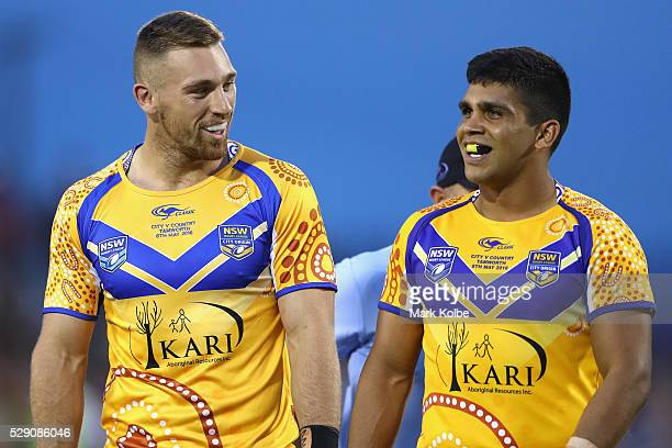 Bryce Cartwright and Tyrone Peachey of City share a laugh during the NSW Origin match between City and Country at Scully Park on May 8 2016 in...
