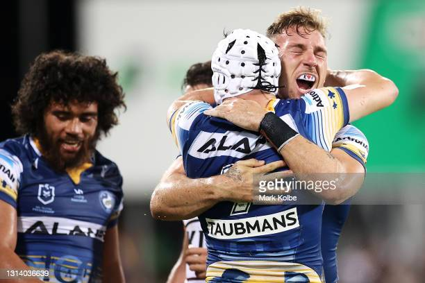 Bryce Cartwright of the Eels celebrates with Reed Mahoney of the Eels after scoring a try during the round seven NRL match between the Parramatta...