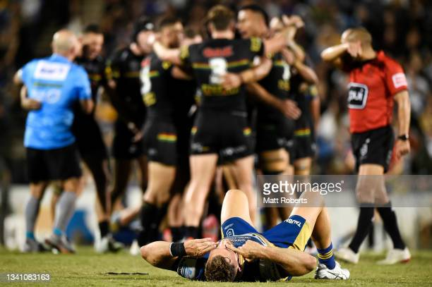 Bryce Cartwright of the Eels looks dejected after defeat as the Panthers celebrate victory during the NRL Semifinal match between the Penrith...