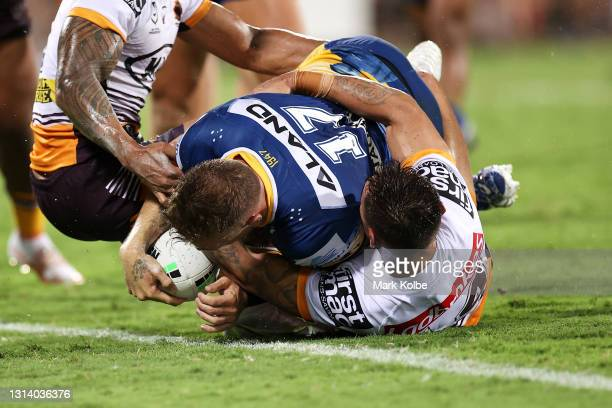 Bryce Cartwright of the Eels scores a try during the round seven NRL match between the Parramatta Eels and the Brisbane Broncos at TIO Stadium, on...