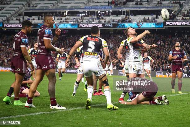 Bryce Cartwright of the Panthers celebrates with his team mates after scoring a try during the NRL Elimination Final match between the Manly Sea...