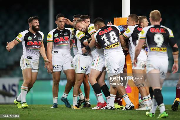 Bryce Cartwright of the Panthers celebrates with team mates after scoring a try during the NRL Elimination Final match between the Manly Sea Eagles...