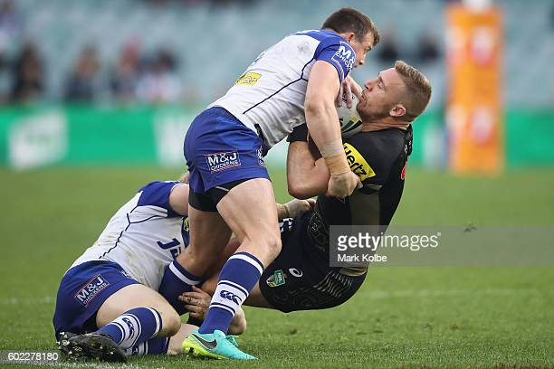 Bryce Cartwright of the Panthers is tackled during the NRL Elimination Final match between the Penrith Panthers and the Canterbury Bulldogs at...
