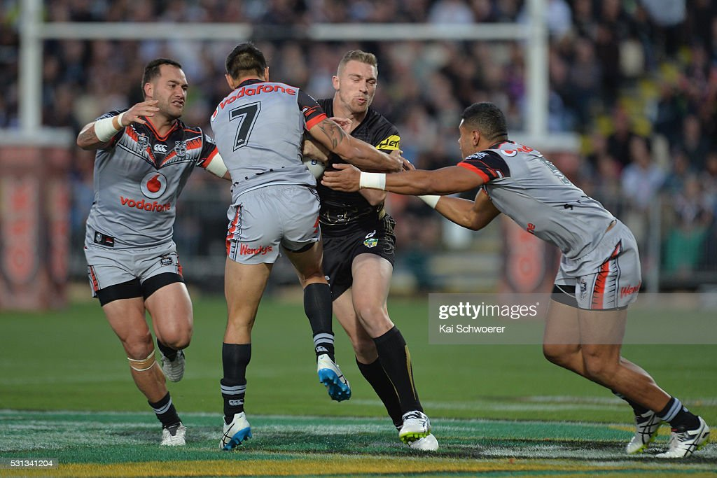Bryce Cartwright of the Panthers is tackled during the round 10 NRL match between the Penrith Panthers and the New Zealand Warriors at AMI Stadium on May 14, 2016 in Christchurch, New Zealand.