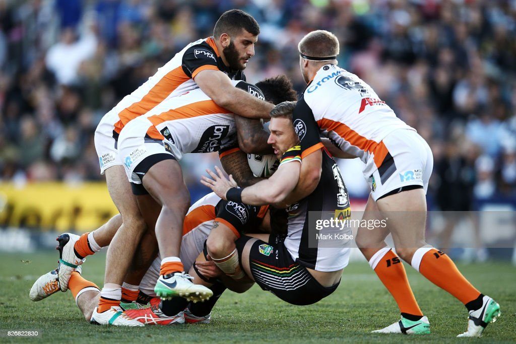 Bryce Cartwright of the Panthers is tackled during the round 22 NRL match between the Penrith Panthers and the Wests Tigers at Pepper Stadium on August 6, 2017 in Sydney, Australia.