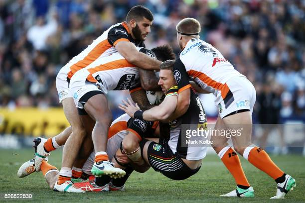 Bryce Cartwright of the Panthers is tackled during the round 22 NRL match between the Penrith Panthers and the Wests Tigers at Pepper Stadium on...