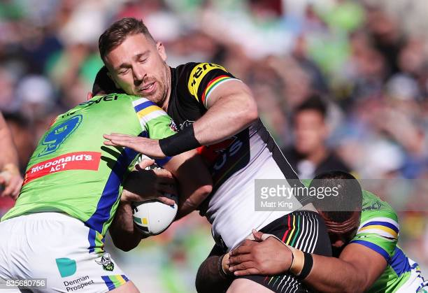 Bryce Cartwright of the Panthers is tackled during the round 24 NRL match between the Canberra Raiders and the Penrith Panthers at GIO Stadium on...