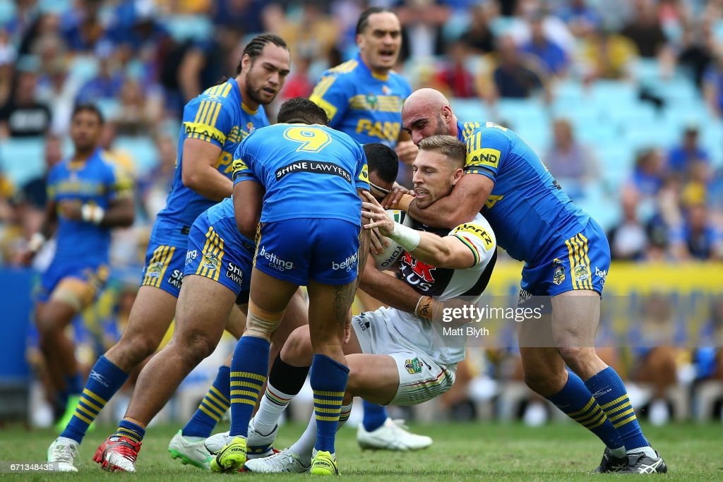 Bryce Cartwright of the Panthers is tackled during the round eight NRL match between the Parramatta Eels and the Penrith Panthers at ANZ Stadium on April 22, 2017 in Sydney, Australia.