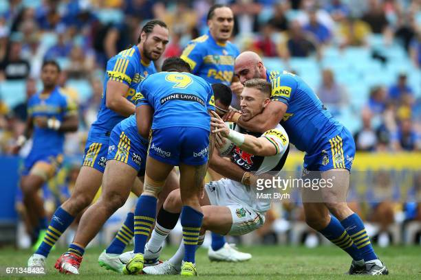 Bryce Cartwright of the Panthers is tackled during the round eight NRL match between the Parramatta Eels and the Penrith Panthers at ANZ Stadium on...