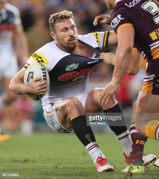 Bryce Cartwright of the Panthers takes a tackle during the NRL Semi Final match between the Brisbane Broncos and the Penrith Panthers at Suncorp...