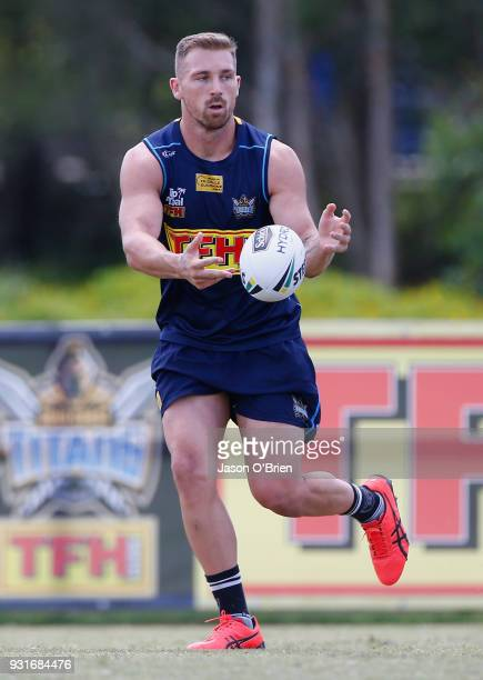 Bryce Cartwright passes the ball during a Gold Coast Titans NRL training session at Parkwood on March 14 2018 in Gold Coast Australia