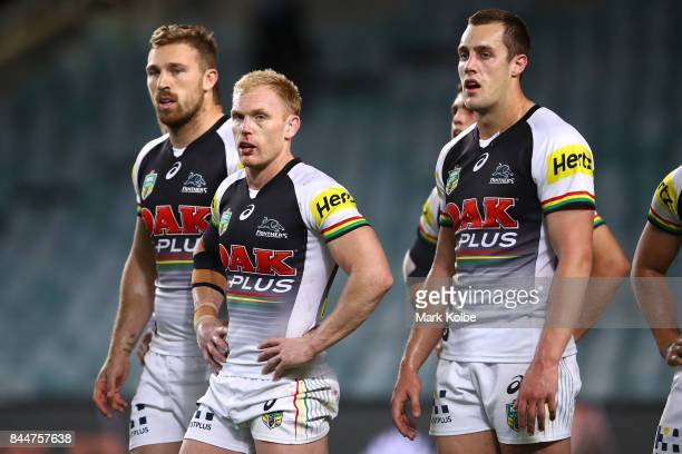 Bryce Cartwright Peter Wallace and Isaah Yeo of the Panthers and their team mates look dejected after an Eagles try during the NRL Elimination Final...