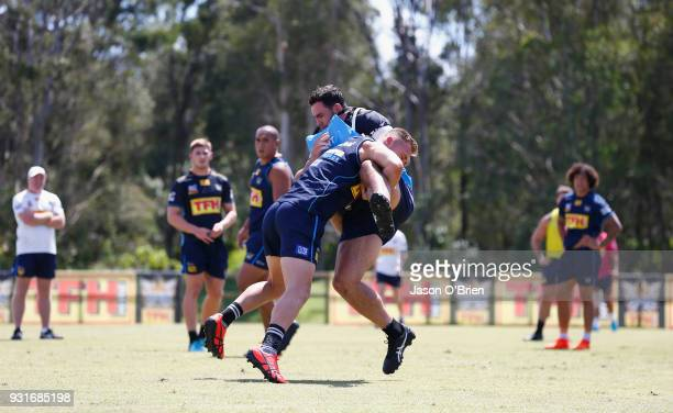 Bryce Cartwright tackles during a Gold Coast Titans NRL training session at Parkwood on March 14 2018 in Gold Coast Australia