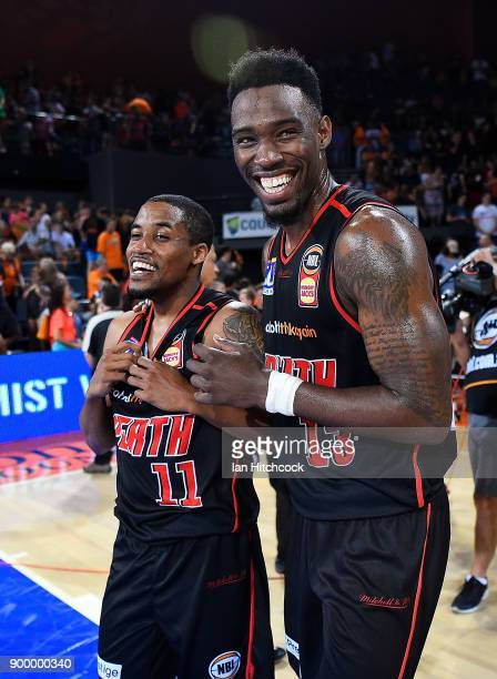 Bryce Cotton and Derek Cooke Jr of the Wildcats celebrate after winning the round 12 NBL match between the Cairns Taipans and the Perth Wildcats at...
